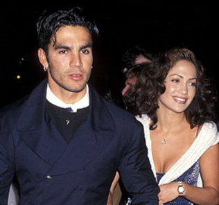 "Actress Jennifer Lopez and husband Ojani Noa attend ""That Old Feeling"" Century City Premiere on March 31, 1997 at Cineplex Odeon Century Plaza Cinemas in Century City, California."