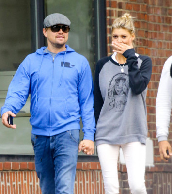 EXCLUSIVE: Leonardo DiCaprio and Kelly Rohrbach are spotted hand-in-hand while taking a romantic stroll in Midtown, New York City  Pictured: Leonardo DiCaprio and Kelly Rohrbach