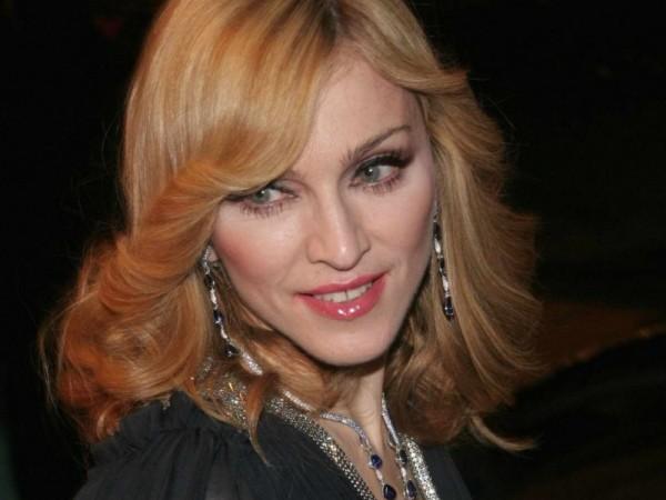 Мадонна организовала слежку за сыном и бывшим супругом