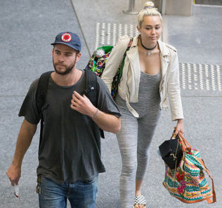 Liam Hemsworth and Miley Cyrus depart Brisbane airport. Liam Hemsworth and Miley Cyrus are seen departing Brisbane airport after spending a week in Byron Bay. Miley wore a grey one piece jumpsuit as she and Liam were escorted from a private entrance into customs.  Pictured: Miley Cyrus and Liam Hemsworth