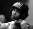 30 May 1963 Territorial Army Drill Hall Shepherds Bush Heavyweight boxer Cassius Clay adjusts the strap on his headgear during a training session.