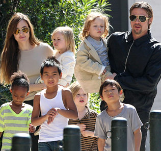 "#7006829 The Jolie-Pitt family headed out in New Orleans, Louisiana to do some grocery shopping at a local market on March 20, 2011. Angelina has brought all six children to visit their dad Brad Pitt while he works on his latest project ""Cogan's Trade"". Maddox, Pax, Zahara and Shiloh walked while the twins Knox and Vivienne hitched a ride from mom and dad who were all smiles while out and about on a lovely sunny day. Brad and Angelina waved to fans as they strolled the street to and from the market. Fame Pictures, Inc - Santa Monica, CA, USA - +1 (310) 395-0500 All Over Press"