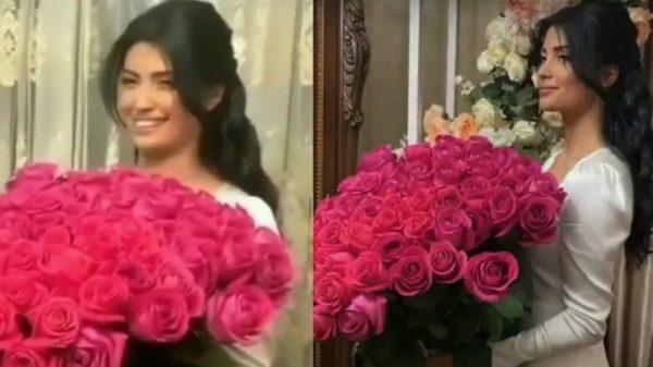 Мадина Плиева на собственной свадьбе счастливая с букетом роз