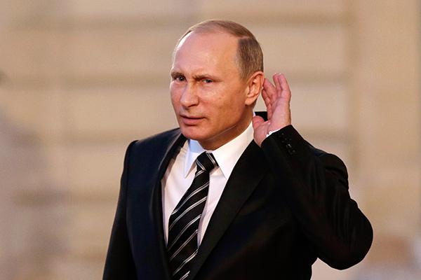 Владимир Путин. Фото: Philippe Wojazer / Reuters