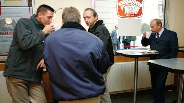 Путин в кофейне Дрездена, фото: РИА Новости